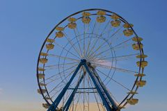 Ferris wheel on blue sky Stock Photos