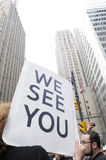 We see you. TORONTO-JUNE 27: A protester carries a sign saying we see you so as to warn the financial institutions during the G20 Protest on June 27, 2010 in Stock Image