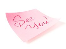 See you message. See you handwritten message on pink sticker stock photos