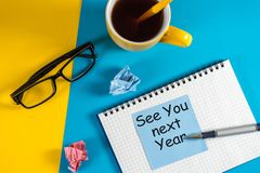 See you next year written on a message at the workplace royalty free stock images