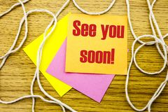 See you soon - word on yellow sticky note in wooden background. Bussines concept. Stock Photography