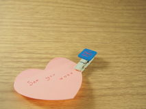 See you on sticky note, heart shape with created paper clip Stock Images
