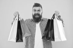See your purchase history. Enjoy shopping profitable deals black friday. Shopping with discount enjoy purchase. Man. Bearded hipster cheerful face carry paper stock images