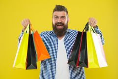 See your purchase history. Enjoy shopping profitable deals black friday. Shopping with discount enjoy purchase. Man. Bearded hipster cheerful face carry paper royalty free stock photo