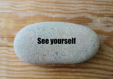 `See yourself`word on the stone - minimal design. `See yourself`word on the stone, minimal design, sucess, spirituality concepts stock image