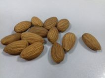 Seed of almond nuts over white Stock Images