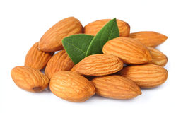 Seed of almonds nuts. With leavs on white Royalty Free Stock Photo