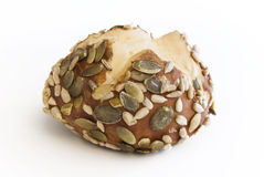 Seed bread. Bun with pumpkin and sunflower seeds royalty free stock photo