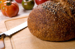 Seed bread. And heirloom tomatoes Royalty Free Stock Photo