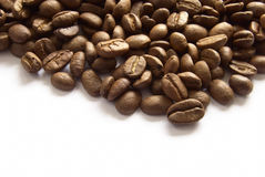Seed of coffee. Heap of brown seed coffe on the white background stock photos