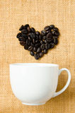 Seed coffee and cup coffee Stock Photos