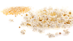 Seed corn and pop corn on the white background Royalty Free Stock Images