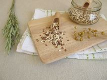 Seed mixture with rolled oats, flaxseeds and sesame Stock Photography