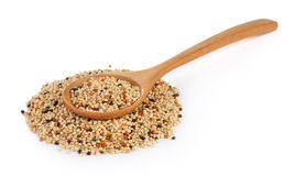 Seed mixture in the wood spoon isolated on white background. Pe Stock Images