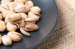 Seed of pistachio nut on wood background Stock Images