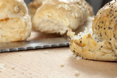 Seeded bread rolls laying on a kitchen worktop Royalty Free Stock Photo