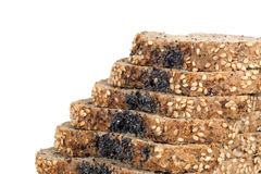 Seeded Bread Slices over White. Slices of seeded bread in a stack, over white background Stock Photography