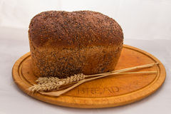 Seeded bread and wheat Stock Photo