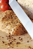 Seeded bread on wooden board Royalty Free Stock Image