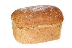 Seeded granary bread. Home baked loaf of seeded granary bread isolated on a white background Stock Photography