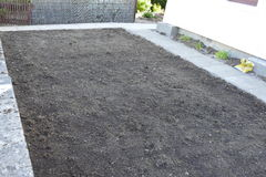 Seeded Ground. A photo of  larger section of garden recently grass seeded Stock Image