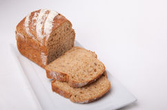 Seeded spelt loaf with honey. Close up of seeded spelt bread loaf which has been partially sliced. Spelt loaf with honey, sunflower seeds and Lupin seeds Royalty Free Stock Images