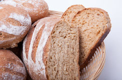 Seeded spelt loaf with honey. Close up of seeded spelt bread loaf which has been partially sliced. Spelt loaf with honey, sunflower seeds and Lupin seeds royalty free stock image