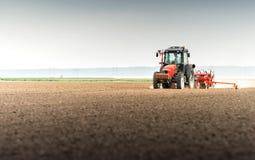 Seeding crops at field Royalty Free Stock Photo