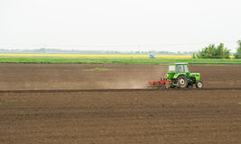 Seeding crops at field Stock Photography