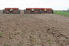 Seeding machines at field Stock Photos