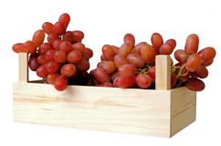 Seedless grapes. In crate isolate on white Royalty Free Stock Photos