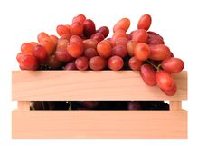 Seedless grapes in wooden case. In market place Royalty Free Stock Photos