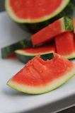 Seedless watermelon on white ceramic platter Stock Images