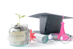 Seedling with education money savings in a glass jar Royalty Free Stock Photos
