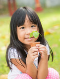 Seedling in little hand Stock Photo