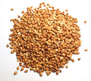 Seeds. Macro photo of buckwheat cereals heap isolated on white royalty free stock photography