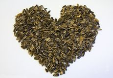 Seeds. A bunch of sunflower seeds in a heart shape Stock Image