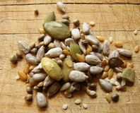 Seeds. Mixed seeds on a wooden board Stock Photography