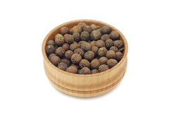 Seeds of allspice in a wooden bowl Royalty Free Stock Photos