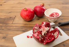 Seeds and arils of a pomegranate. Inside of a pomegranate with its arils and red seeds stock photography