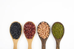 Seeds beansBlack Bean, Red Bean, Peanut and Mung Bean useful for health in wood spoons on white background.  Royalty Free Stock Images