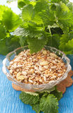 Seeds in  bowl with herbs Royalty Free Stock Images