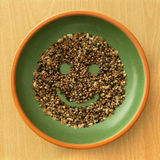 Seeds in Bowl with a Smile!. Variety of seed in bowl and smiley face stock photo