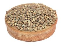 Seeds of Cannabis. In a wooden bowl over white Royalty Free Stock Image