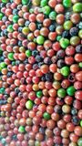 Seeds. Colorful peper seeds close up on wooden table Stock Photo