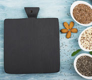 Seeds of flax, chia, quinoa: modern superfoods, healthy food ingredients, diets, breakfast. Top View. Seeds of flax, chia, quinoa: modern superfoods, healthy stock image