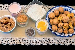 Seeds and grain healthy vegetal breakfast or snack. Bowls and glasses with different healthy seeds and grain, buckwheat porridge and tapioca pudding, sour stock images