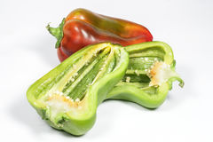 Seeds of green pepper cut in half, on white Stock Photo