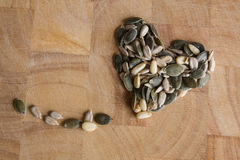 Seeds in heart shaped form Stock Photos