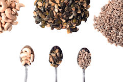 Seeds and nuts in spoons Stock Photo